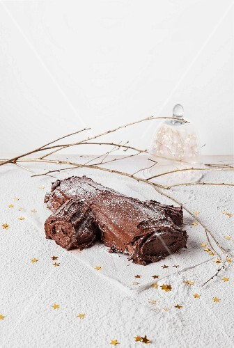 A yule log with raspberries for Christmas
