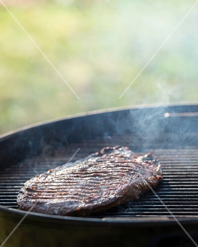 A flank steak on a barbecue