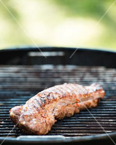 Pork fillet on a barbecue