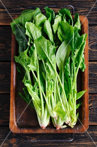 Fresh spinach in a rustic roasting tin