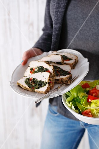 Turkey breast slices filled with spinach and pepper served with a mixed salad
