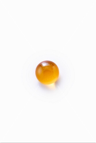 A drop of honey on a white surface