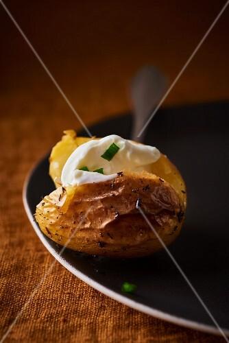 A baked potato with chive crème fraîche