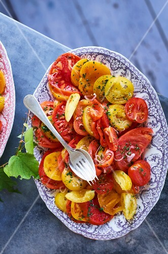 Juicy tomato salad with red and yellow tomatoes