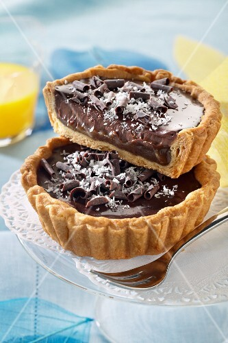 Exotic tartlets with dark chocolate cream and pineapple