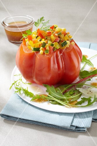 A beefsteak tomato filled with vegetables