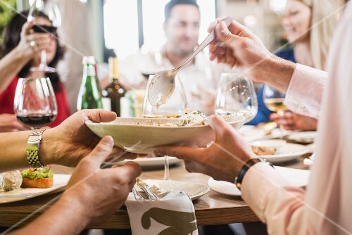 People eating and drinking in an Italian restaurant