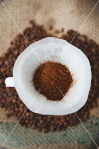 Coffee powder in a filter on coffee beans