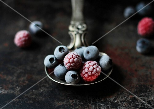 Frozen berries on a silver spoon