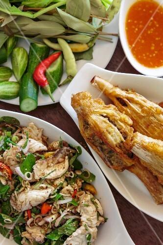Fish salad, stuffed bamboo and chilli sauce
