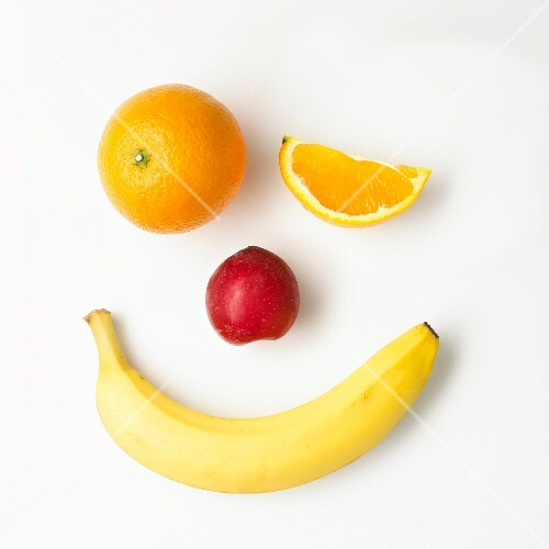 A fruit face on a white surface