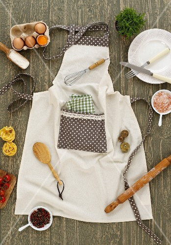 Various ingredients and kitchen utensils on an apron