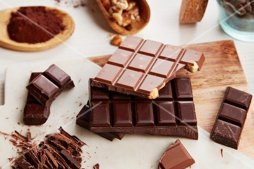 An arrangement of various chocolate bars and cocoa