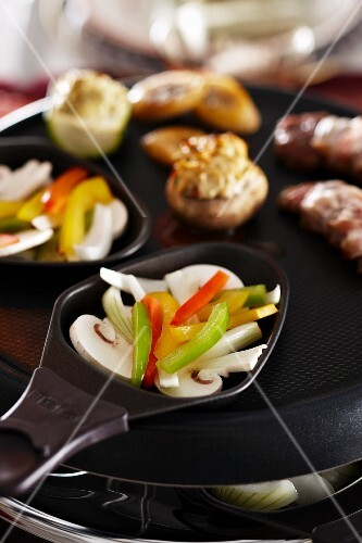 Raclette with vegetables and mushrooms