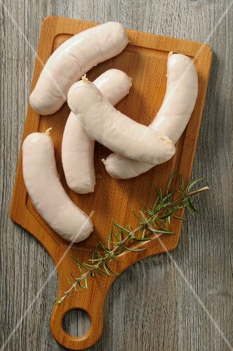 Boudin Blanc (French white sausage) on a wooden board