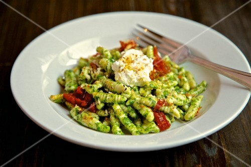 Fusilli pasta with pesto, dried tomatoes and ricotta cheese