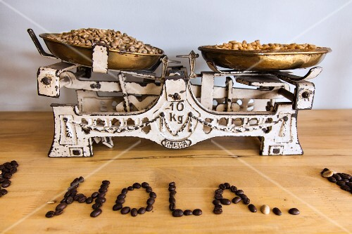 Coffee beans on an old pair of scales in a cafe in Bogota, Colombia