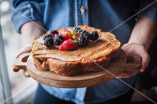 Organic, gluten-free pear tart with fresh berries