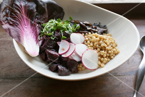 Wheat salad with radishes, beetroot, cress and red lettuce