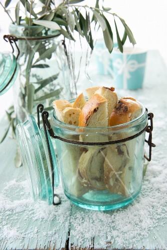 Slices of sweet bread in an old flip-top jar
