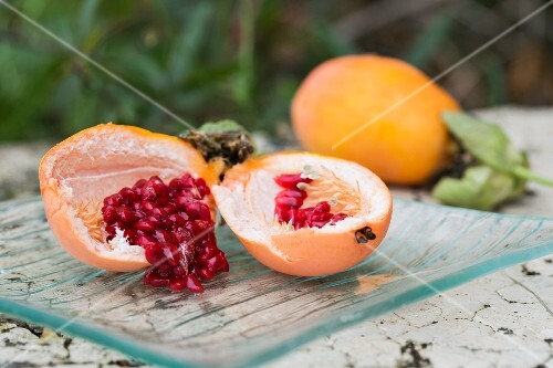 A sliced passion fruit on a table outside