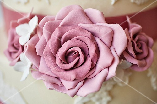 A wedding cake decorated with marzipan roses (detail)