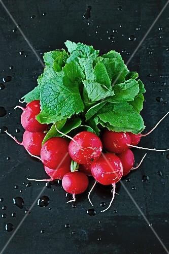 A bundle of freshly washed radishes