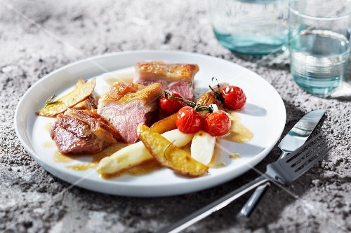 Rare saddle of lamb with vegetables and potatoes