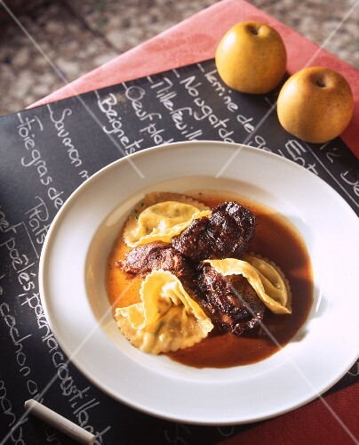Beef in an apple wine sauce with ravioli
