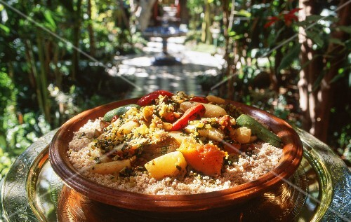 Moroccan-style couscous in a large terracotta dish