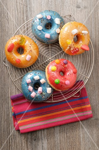 Doughnuts with coloured sugar glaze