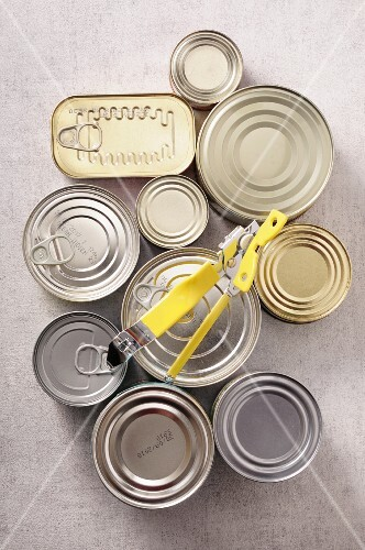 Various tins of food with a tin opener (seen from above)