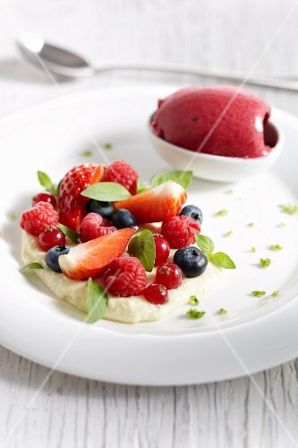 Vanilla mousse with fresh berries and berry sorbet