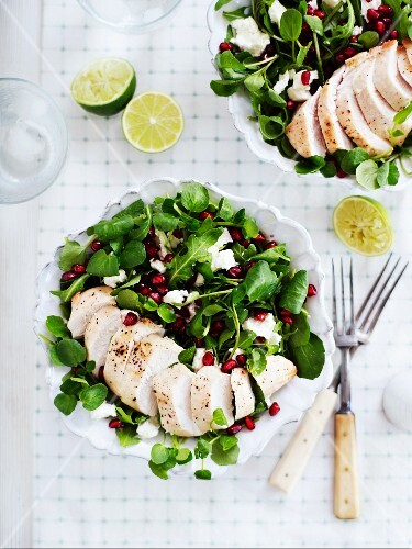 Lambs lettuce with chicken, pomegranate seeds and feta cheese