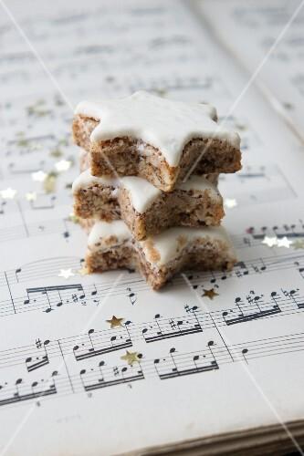Three cinnamon stars on a piece of sheet music