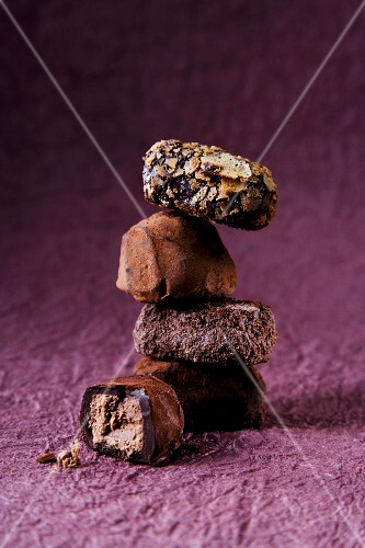A stack of pralines on a purple surface