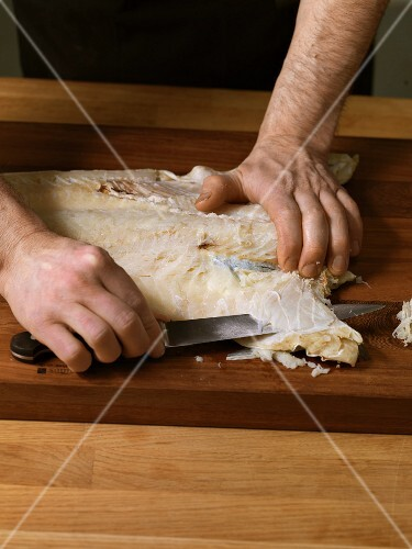 Softened dried fish being carved