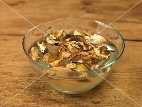 Dried mushrooms being softened in warm water for later use