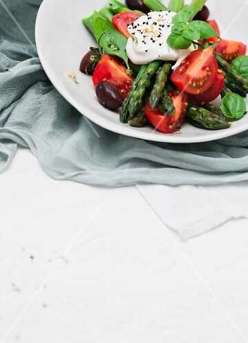 Asparagus and tomato salad with olives, basil and yoghurt dressing