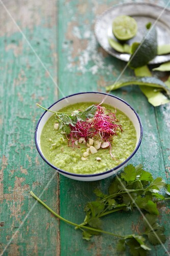 Papaya and avocado soup with nuts and coriander