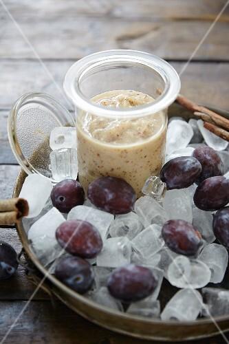 A plum smoothie in a jar