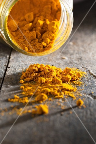 Turmeric powder on a wooden table