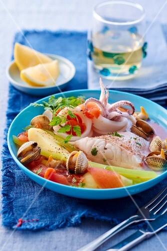 Pot au feu with fish and seafood