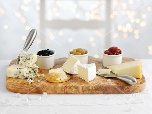 Three types of cheeses with accompanying chutneys
