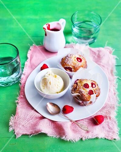 Raspberry muffins and vanilla ice cream served with raspberry sauce