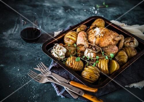 Roast chicken with hasselback potatoes
