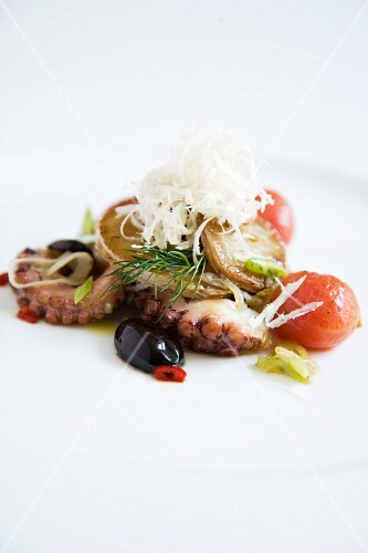 Octopus Gröstl (typical Tirolean dish using leftovers) with fresh seafood and spring onions