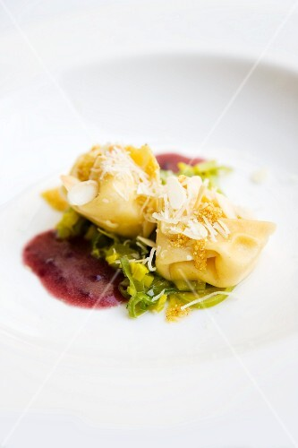 Tortellini filled with alpine cheese on a leek medley with red wine jus