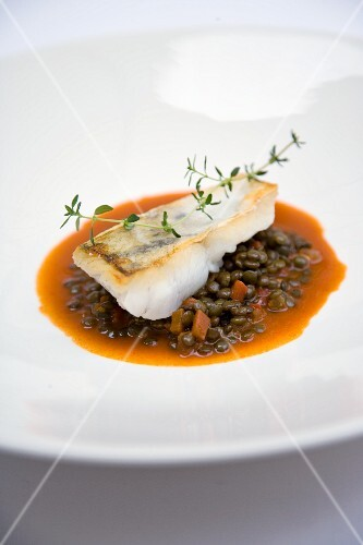 Fried zander fillet on a lentil goulash