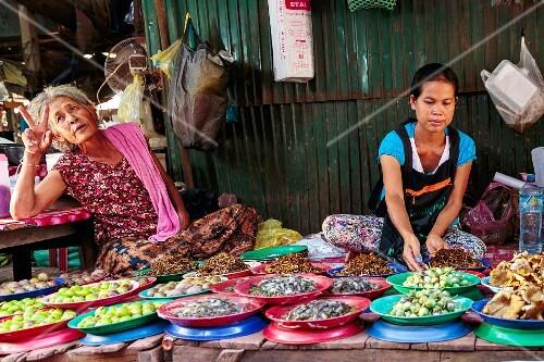 Women sitting of the market stand, Vientiane, Laos